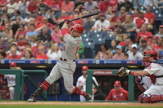 Jun 7, 2019; Philadelphia, PA, USA; Cincinnati Reds first baseman Joey Votto (19) hits a home run during the first inning of the game against the Philadelphia Phillies at Citizens Bank Park. Mandatory Credit: John Geliebter-USA TODAY Sports