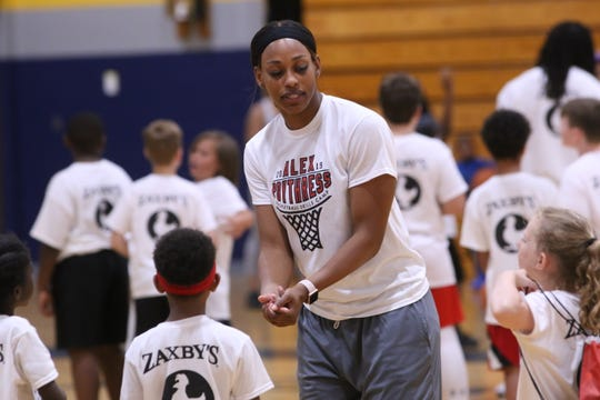 Former Clarksville High and Lady Vols star Bashaara Graves gives instructions to campers during the Alex Poythress youth basketball camp in June at Northeast High in Clarksville.