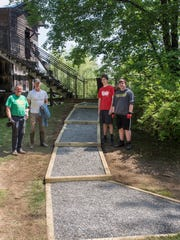 (Left to right) Bob Jones, assistant scoutmaster; Scott Weiss, father and assistant scoutmaster; Callum Weiss, and Ben Barno, Eagle Scout from Troop 121.