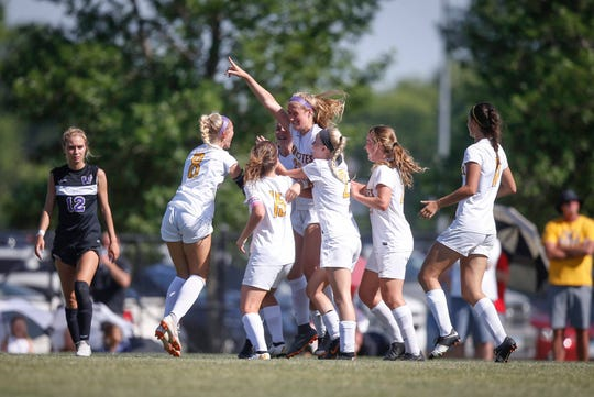Members of the Ankeny girls soccer team celebrate after a scoring a goal late in the second half against Waukee during the 2019 Iowa high school girls state soccer tournament at Cownie Soccer Complex in Des Moines on Saturday, June 8, 2019.
