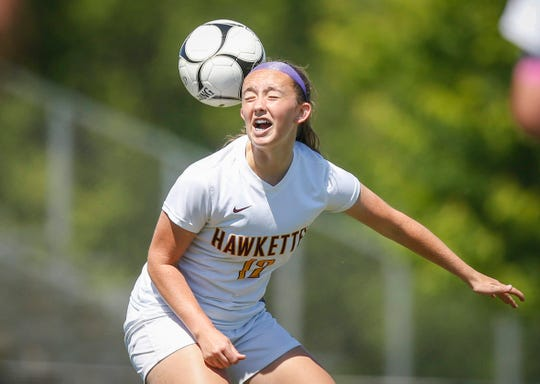 Ankeny senior Cambri Mason heads the ball against Waukee during the 2019 Iowa high school girls state soccer tournament at Cownie Soccer Complex in Des Moines on Saturday, June 8, 2019.