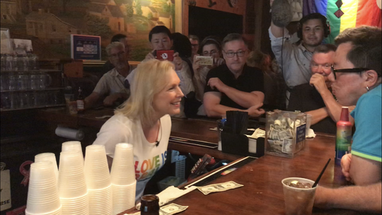 U.S. Sen. Kirsten Gillibrand speaks with Pride attendees at the Blazing Saddle on June 7, 2019.