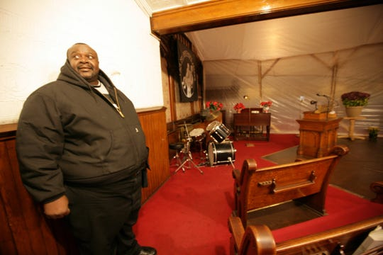 """Pastor Henry Covington talks about the need in the for repairs in the sanctuary during the """"I Am My Brother's Keeper"""" outreach program for the homeless at Pilgrim Church in Detroit. Thursday, December 11, 2008  Covington died in 2010 after suffering a heart attack."""
