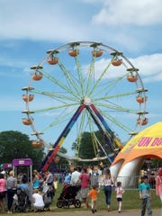 Carnival rides and midway games are among the attractions at Liberty Fest.