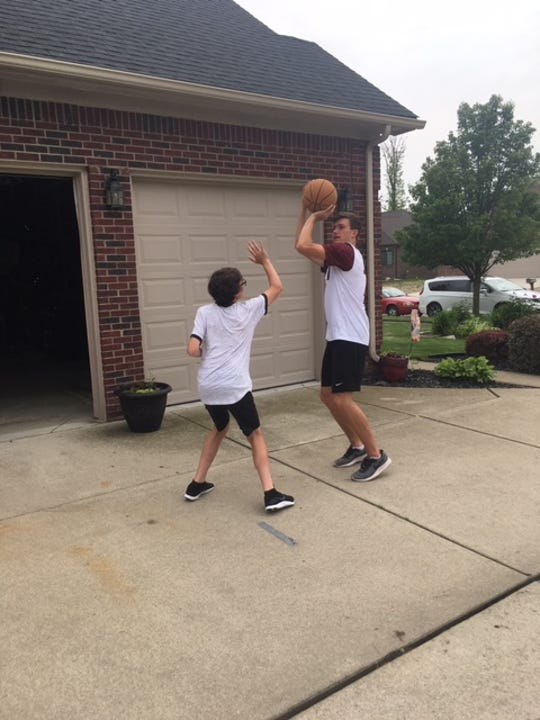 Colin Czajkowski and his younger brother Ethan play basketball during the MLB draft Tuesday.