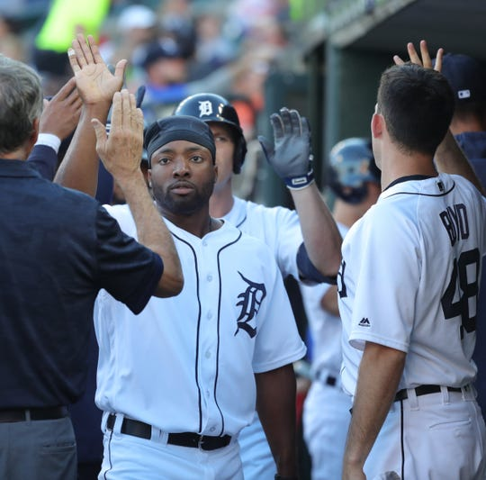 Detroit Tigers left fielder Christin Stewart high-fives teammates after scoring during the first inning against the Minnesota Twins, Friday, June 7, 2019 at Comerica Park.