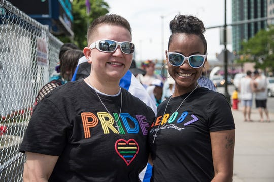 Angel Francis and her fiancŽ Kris Francis, both of Belleville wait in line to enter the Motor City Pride at Hart Plaza in Detroit, Saturday, June 8, 2019.