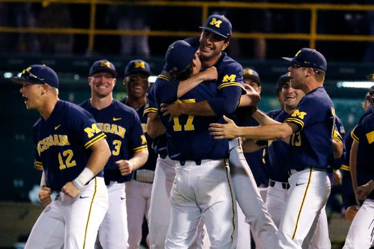 Michigan's pitcher Jeff Criswell (17) celebrates with teammates after Michigan defeated UCLA 3-2 during an NCAA tournament super regional game in Los Angeles, Friday, June 7, 2019.
