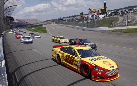 Pole-sitter Joey Logano leads the field during the NASCAR Sprint Cup series Pure Michigan 400 auto race at Michigan International Speedway in Brooklyn, Mich., Sunday, Aug. 18, 2013. (AP Photo/Paul Sancya)