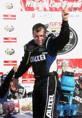 Ryan Newman celebrates his victory in the NASCAR GFS Marketplace 400 at Michigan International Speedway in Brooklyn, Mich., Sunday, Aug. 17, 2003. (AP Photo/Paul Sancya)