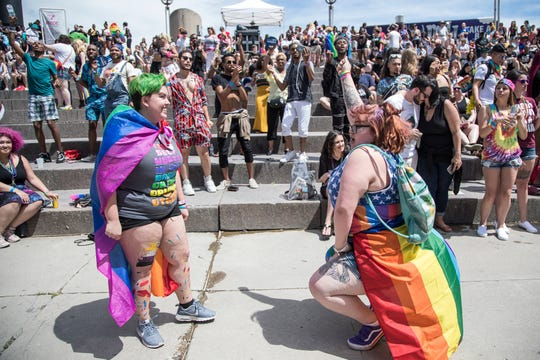Haley Utley, left, and Madison Suchy both of Lapeer, dance near the Pride Stage during the Motor City Pride at Hart Plaza in Detroit, Saturday, June 8, 2019.