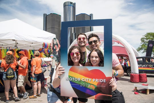 Anna Militello, Peter Maniaci both of St. Clair Shores, Justice Wong, Westland and Amanda Guido of Dearborn pose for a photo during the Motor City Pride at Hart Plaza in Detroit, Saturday, June 8, 2019.