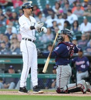 Detroit Tigers right fielder Nicholas Castellanos takes first base after being hit by a pitch against the Minnesota Twins during the first inning Friday, June 7, 2019 at Comerica Park.