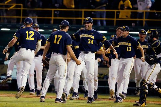 Michigan pitcher Jeff Criswell (17) celebrates with teammates after Michigan defeated UCLA during an NCAA college baseball tournament super regional game in Los Angeles, Friday, June 7, 2019. Michigan won 3-2.
