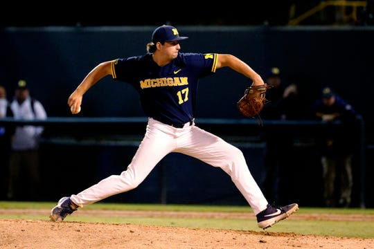 Michigan's Jeff Criswell pitches to a UCLA batter during the ninth inning of an NCAA tournament super regional game in Los Angeles, Friday, June 7, 2019. Michigan won, 3-2.