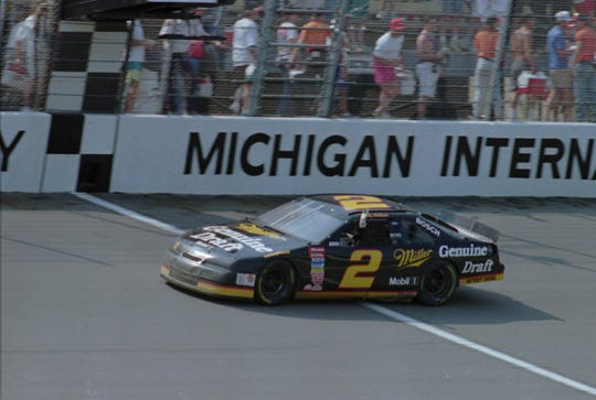 [MILLER 400]Rusty Wallace from Concord, N.C., crosses the finish line at the Miller Genuine Draft 400 at Michigan International Speedway in Brooklyn, Mich., Sunday, June 19, 1994. Wallace won the event after taking a late lead in his Ford Thunderbird.(AP Photo/Werner Slocum)