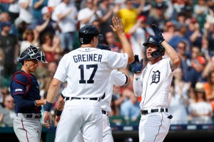 Detroit Tigers' JaCoby Jones, right, celebrates his three-run home run with Grayson Greiner and Gordon Beckham in the second inning.