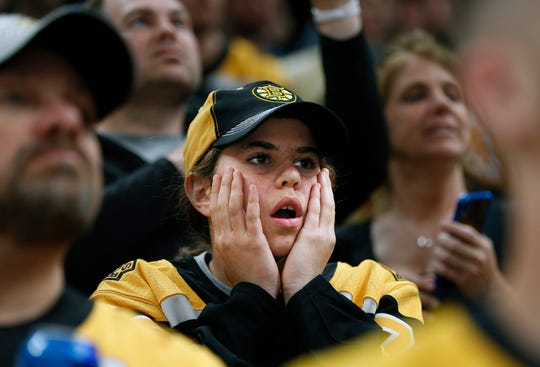 Boston Bruins fans watch the closing minutes of Game 5.