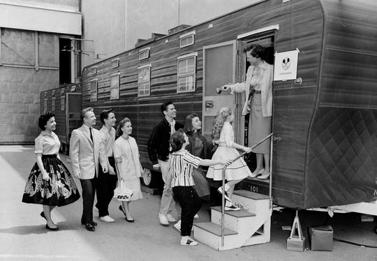 In this Aug 20, 1957, file photo, Walt Disney's Mouseketeers enter a large trailer that serves as their school on the Disney lot in Hollywood, Calif.