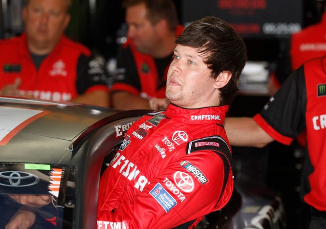 Erik Jones enters his car for a practice session Friday.