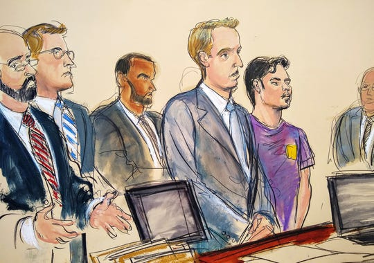 In this courtroom drawing, Ashiqul Alam, fifth from left, makes his initial court appearance and is arraigned at federal court in the Brooklyn Borough of New York, Friday, June 7, 2019.