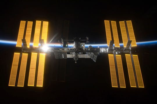 This March 25, 2009 photo provided by NASA shows the International Space Station seen from the Space Shuttle Discovery during separation.