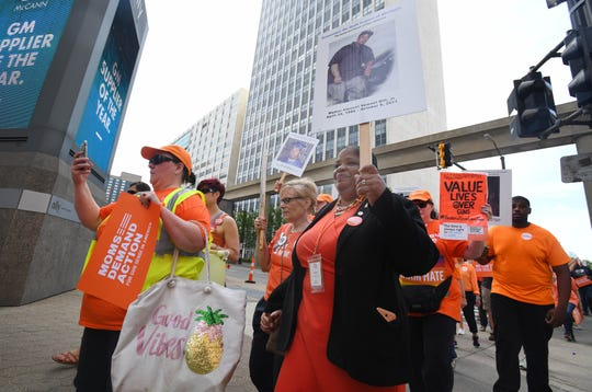 State Rep. Brenda Carter, right, whose nephew was killed and her son shot due to gun violence, marches in the Wear Orange March.