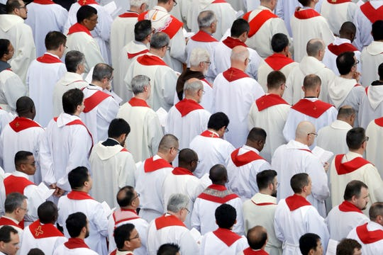 Prelates attend a Pentecost Vigil mass celebrated by Pope Francis in St. Peter's Square, at the Vatican, Saturday, June 8, 2019.