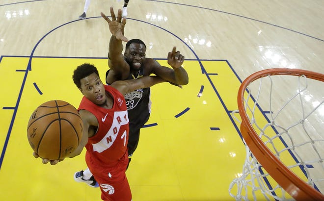 Toronto Raptors guard Kyle Lowry (7) shoots in front of Golden State Warriors forward Draymond Green during the second half.