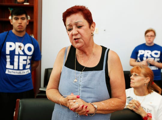In this July 28, 2009 file photo, Norma McCorvey, right, the plaintiff in the landmark lawsuit Roe v. Wade, speaks up as she joins other anti-abortion demonstrators inside House Speaker Nancy Pelosi's office on Capitol Hill in Washington.