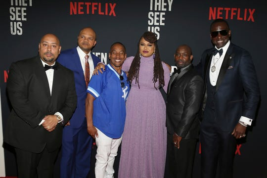 "Director Ava DuVernay, center, with the Central Park 5: Raymond Santana, left, Kevin Richardson, Korey Wise, Anthony McCray and Yuesf Salaam, attend the world premiere of ""When They See Us"" May 20 at the Apollo Theater in New York."