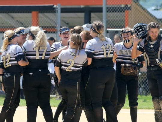 Corning players celebrate their 3-1 win over John Jay-East Fishkill in a Class AA softball state quarterfinal June 8, 2019 at Union-Endicott High School.