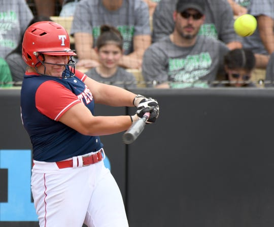 Tecumseh's Leah Beach drives in a first inning run in a 2-1 loss in the Class 2A State Softball Finals to Bremen in West Lafayette on June 8, 2019.