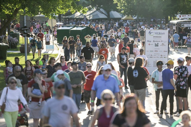 Thousands of people crowd Lakeside Park Friday, June 7, 2019, in Fond du Lac, to take part in Walleye Weekend.