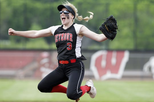 Seymour pitcher Paige Weyer celebrates after the final out was recorded against Monroe on Saturday in Madison, giving the Thunder the Division 2 state championship.