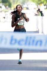 Risper Gesabwa won the women's race at the Bellin Run on Saturday with a time 33 minutes, 23 seconds.