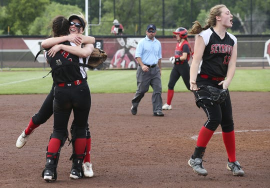 Seymour's Chloe Evans (12) and Paige Weyer (3) celebrate after the Thunder won the WIAA Division 2 state championship over Monroe on Saturday at Goodman Diamond in Madison.