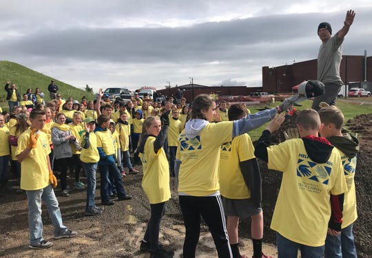 NorthWestern Energy superintendent Jeremy Butcher (upper right) gets a show of hands from many of 100 LDS youngsters who have volunteered to work on the Cascade track remodel at Forzley-Perrine Field Saturday.