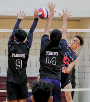 Enrique Untalan of the Guahan Boys White delivers a spike through Prodigy blockers during the 2019 Guahan Boys Volleyball U19 Invitational Tournament held at the Phoenix Center on June 7.