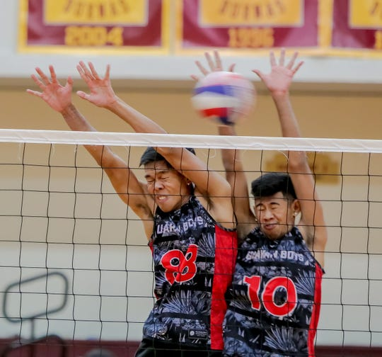 Guahan Boys White attempts to block a spike by Prodigy during the 2019 Guahan Boys Volleyball U19 Invitational Tournament held at the Phoenix Center on June 7.