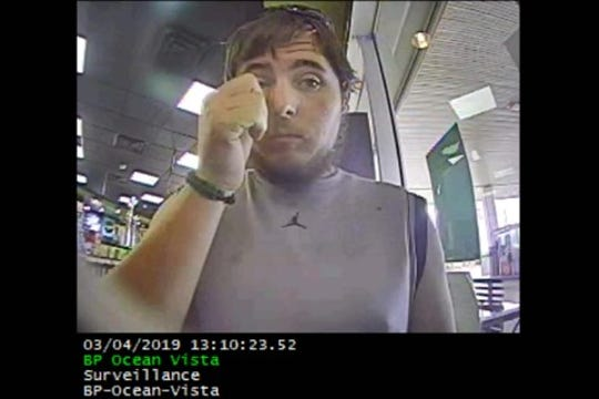 Image of a male suspect wanted in connection with an ATM fraud case.