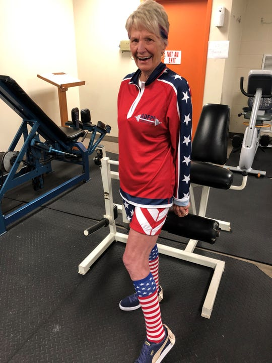 Anne Clark, 70 of Columbia, Missouri, shows off her stars-and-stripes attire after competing in the Single Event World Powerlifting Competition Saturday at the JFK Center in Henderson.
