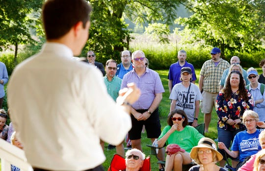 Local residents listen to Democratic presidential candidate Pete Buttigieg speak during a house party, Friday, June 7, 2019, in Winterset, Iowa. (AP Photo/Charlie Neibergall)