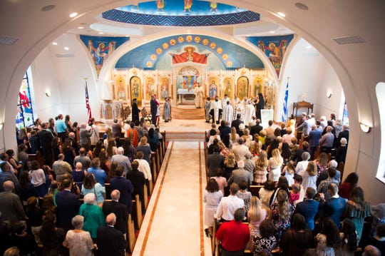 Attendees stand during a special vespers service at St. George Greek Orthodox Church on Saturday.