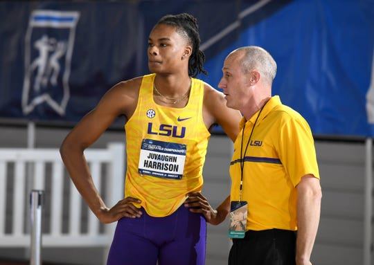 Mar 9, 2019; Birmingham, AL, USA; LSU Tigers jumps coach Todd Lane (right) talks with high jumper JuVaughn Harrison during the NCAA Indoor Track & Field Championships at Birmingham CrossPlex. Mandatory Credit: Kirby Lee-USA TODAY Sports