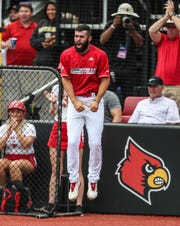 Louisville's Alex Binelas jumps in jubilation after Drew Campbell's triple drove in two runs to help give the Cards a 2-0 early lead against East Carolina in Saturday's Super Regional at Patterson Stadium. June 8, 2019.