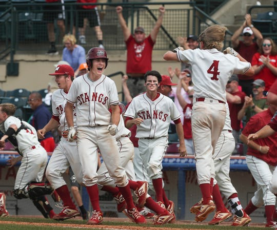 McCraken County celebrates beating Trinity June 8, 2019 to advance to the KHSAA state baseball championship game.