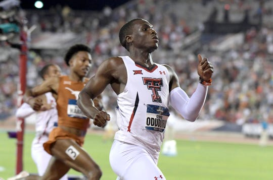 Jun 7, 2019; Austin, TX, USA; Divine Oduduru of Texas Tech celebrates after winning the 200m in 19.73 during the NCAA Track & Field Championships at Mike A. Myers Stadium. Mandatory Credit: Kirby Lee-USA TODAY Sports