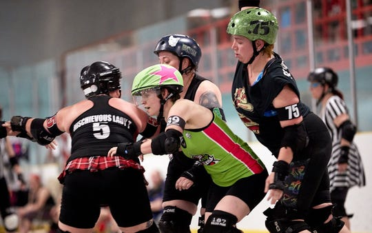 The Lansing Derby Vixens play their home bouts at the Summit in Dimondale.