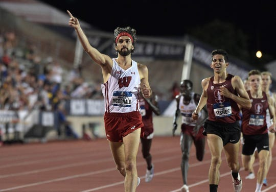 Jun 7, 2019; Austin, TX, USA; Morgan McDonald of Wisconsin celebrates after defeating Grant Fisher of Stanford to win the 5,000m in 14:06.01 during the NCAA Track & Field Championships at Mike A. Myers Stadium. Mandatory Credit: Kirby Lee-USA TODAY Sports
